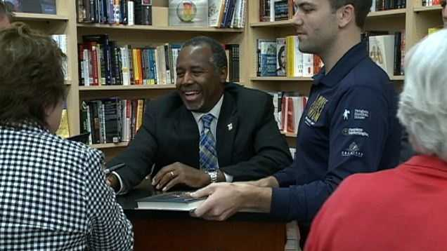 Republican presidential hopeful Ben Carson stopped in Omaha on Friday night to sign books at the Book Worm Shop.
