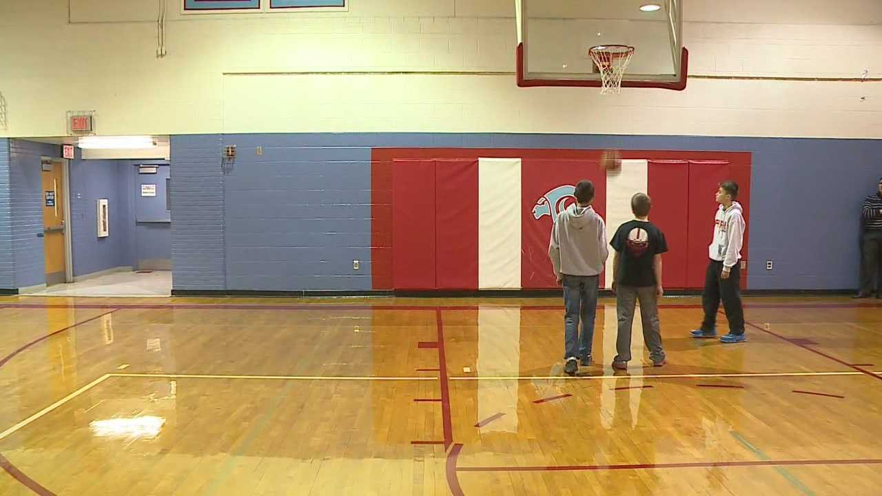 Michael Madej, a boy with special needs, volunteers for several teams at Ralston Middle School. He's been the boys basketball team manager for two years.