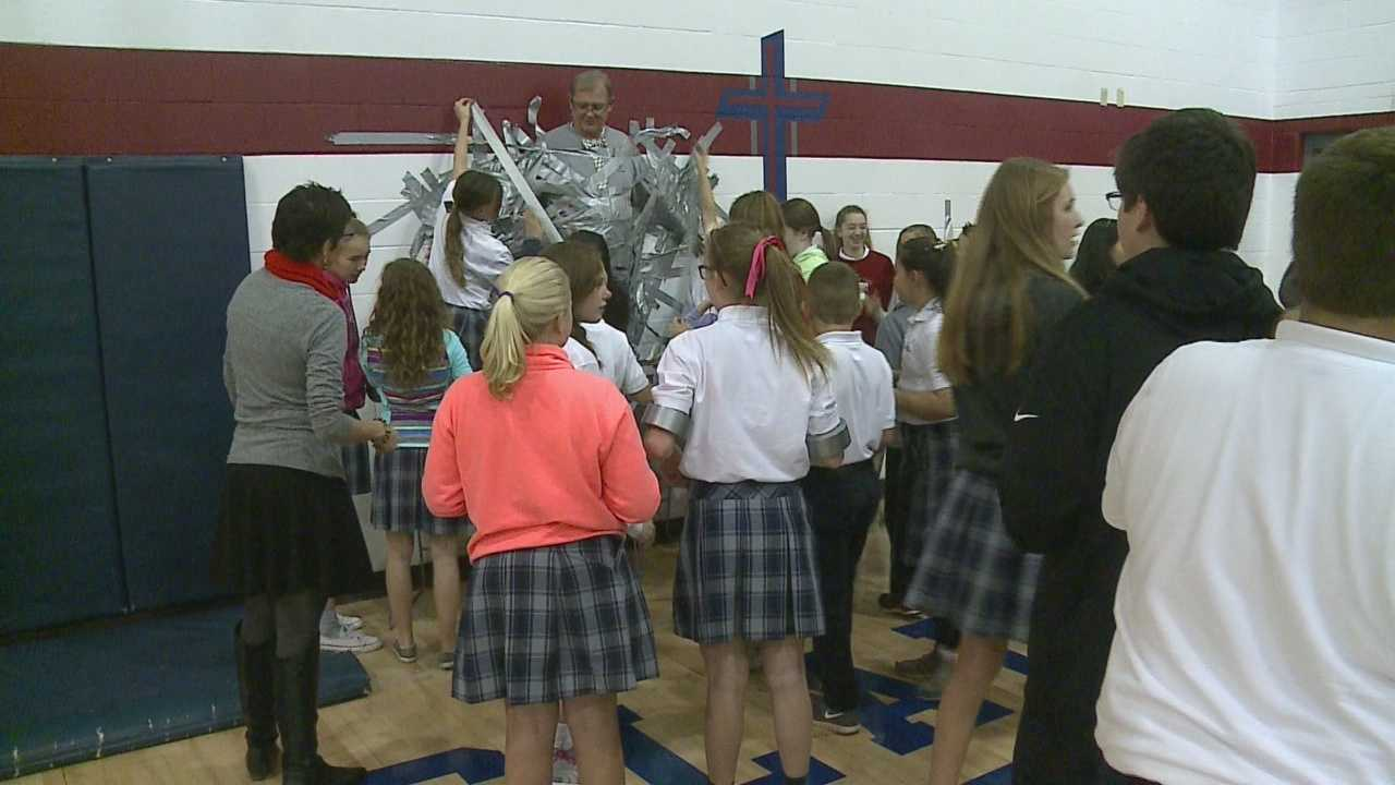 Student at St. Wenceslaus duct tape the principal to a wall after raising food for an annual drive.