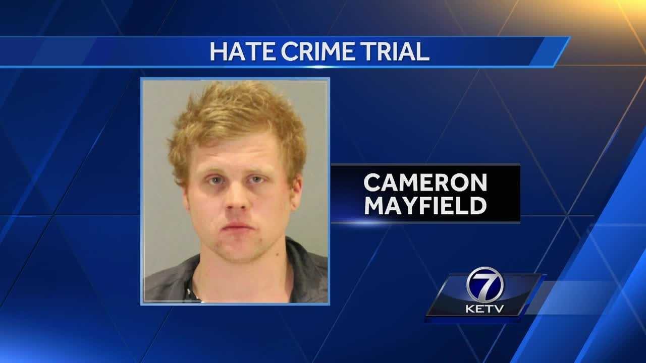 Prosecutors argue that Cameron Mayfield committed a hate crime when they say he stole the flag, set it on fire and ran back into the couple's yard.
