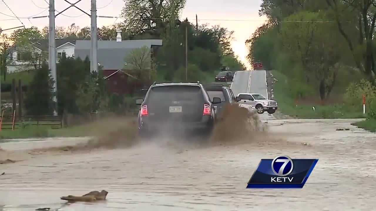 Flooding caused roads to close and hail left damage behind in the Valley area.