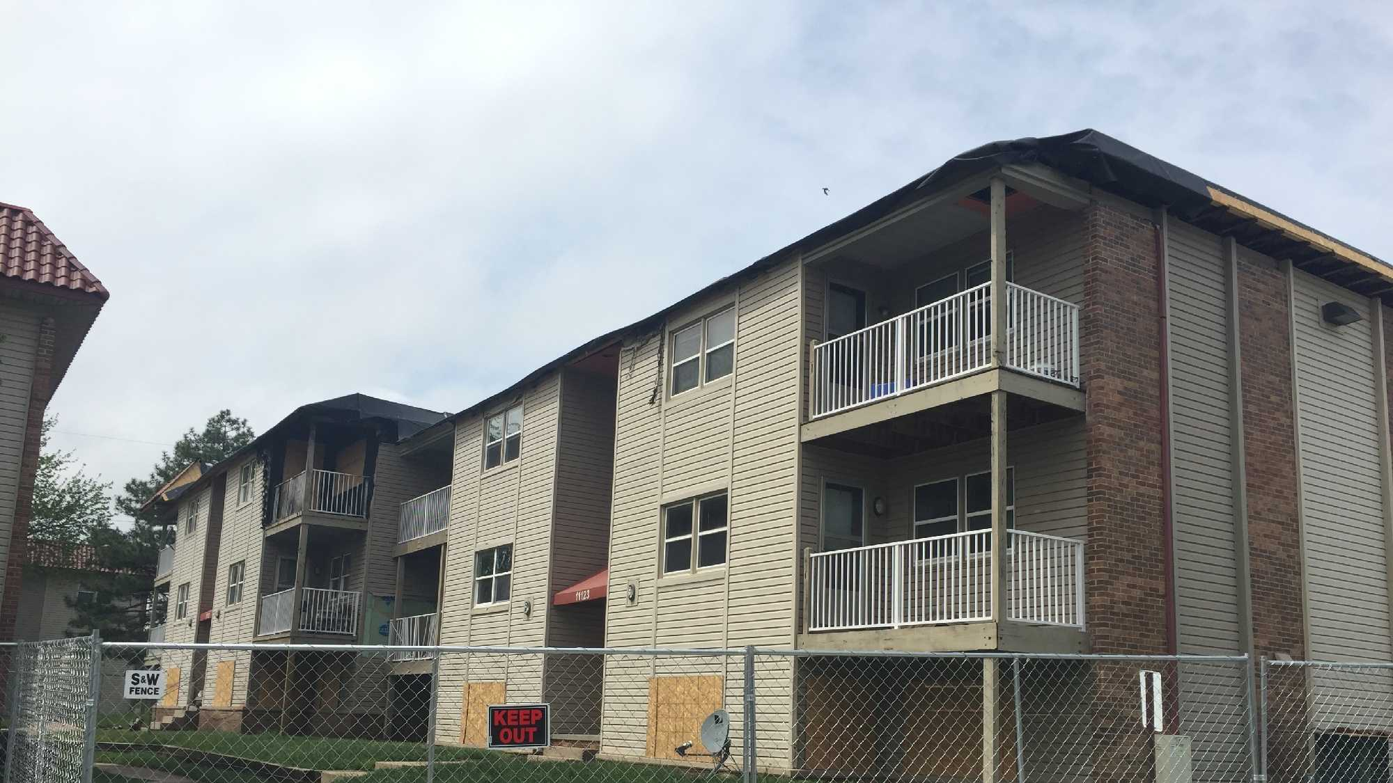 Prosecutors are considering filing criminal charges against a woman in connection to a west Omaha apartment fire that started as result of charcoal grill on her deck.