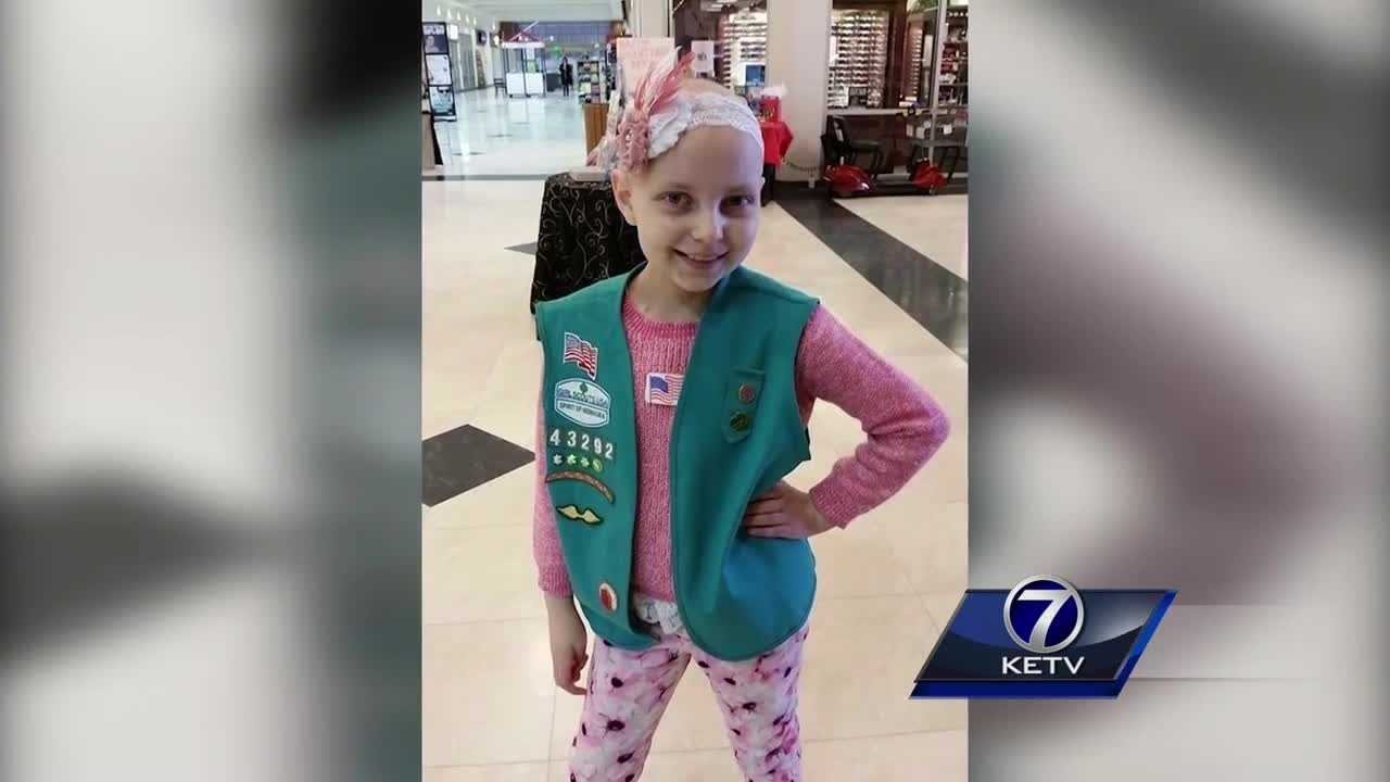 Brain cancer took a 10-year-old Papillion girl's hair, but she is battling back.