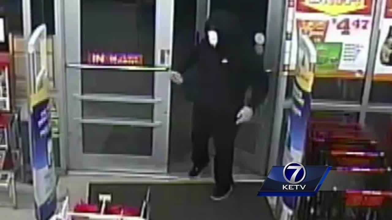 Omaha police are searching for two armed men who robbed a Family Dollar store on June 9.