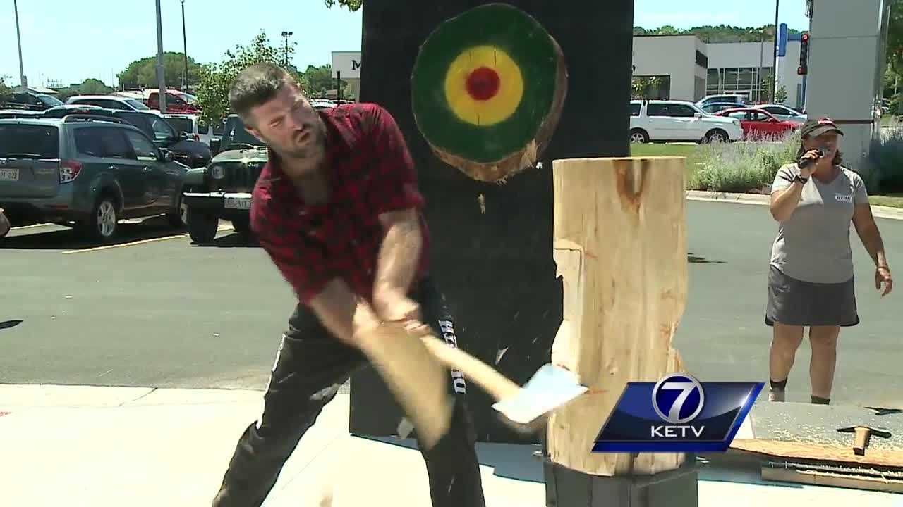 From throwing axes to chopping wood, professional lumberjacks entertained a crowd at the new Duluth Trading Company Store in Omaha Thursday.