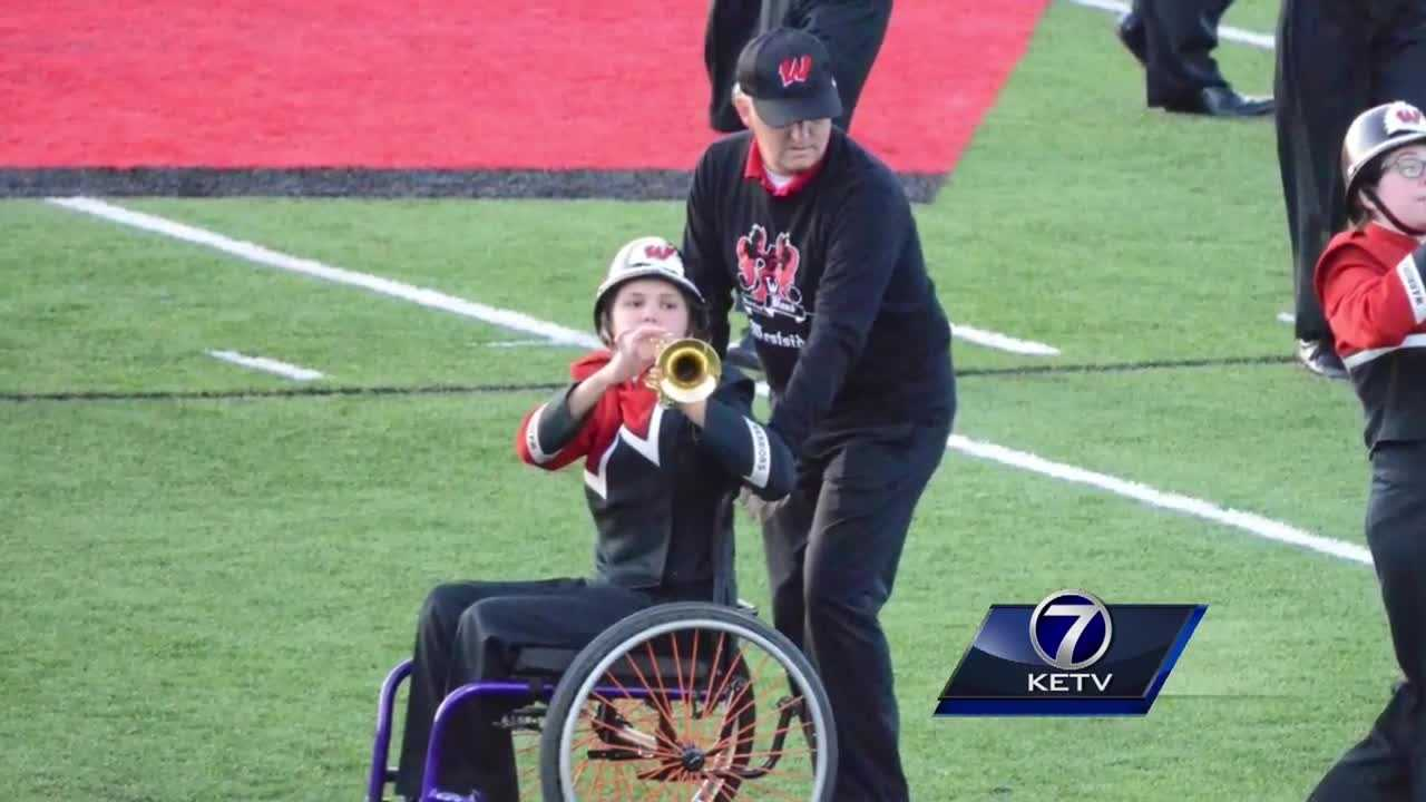 Father Helps Daughter in Marching Band