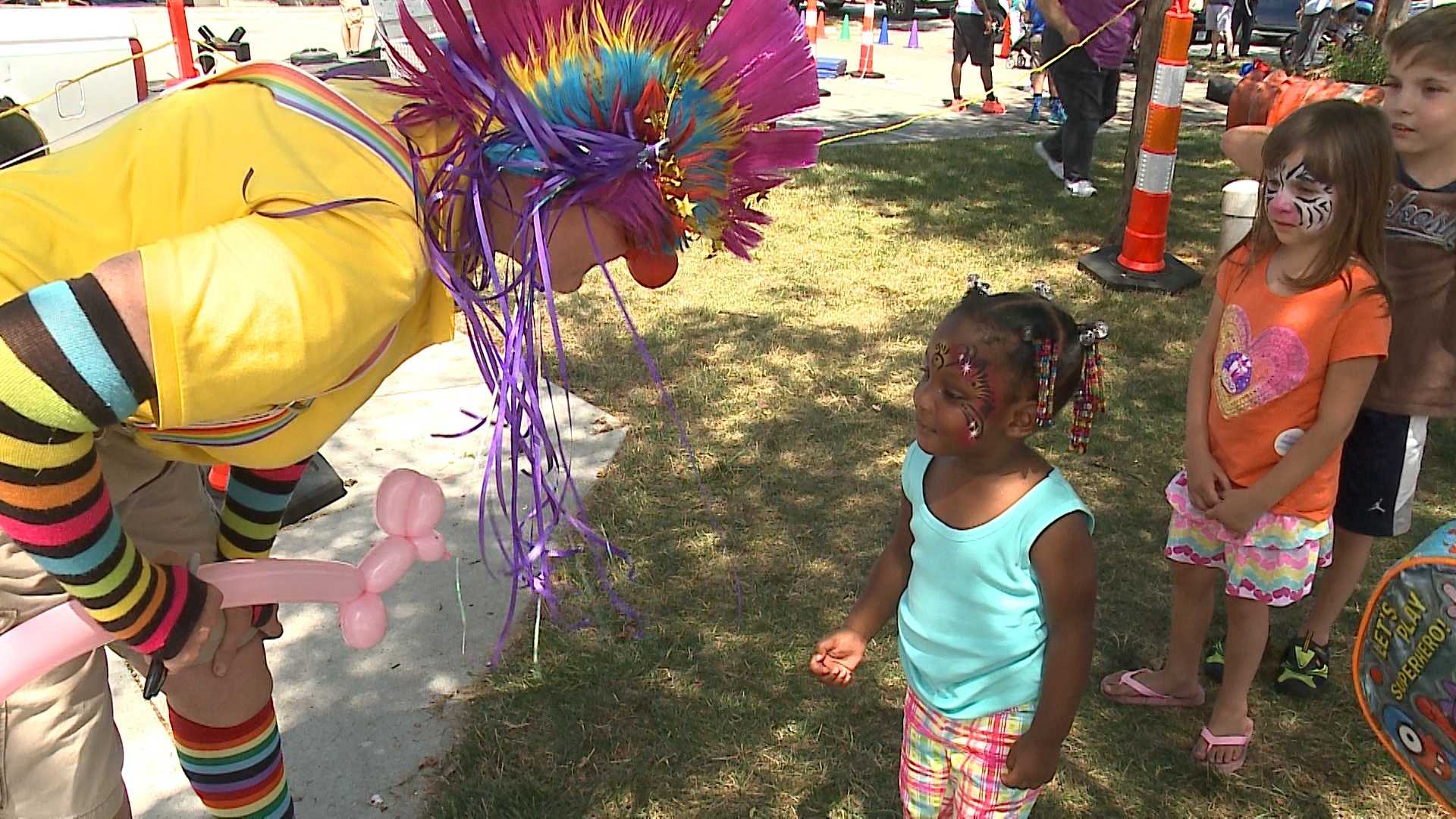 Omaha's Benson neighborhood is drawing a big crowd Saturday for its annual summer festival.
