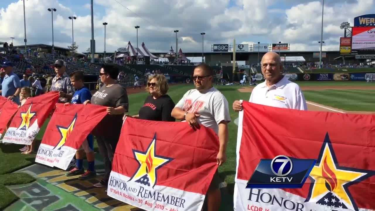 The excitement and energy at Sunday's Omaha Storm Chasers baseball game was interrupted for a time for reflection, remembrance and honor.