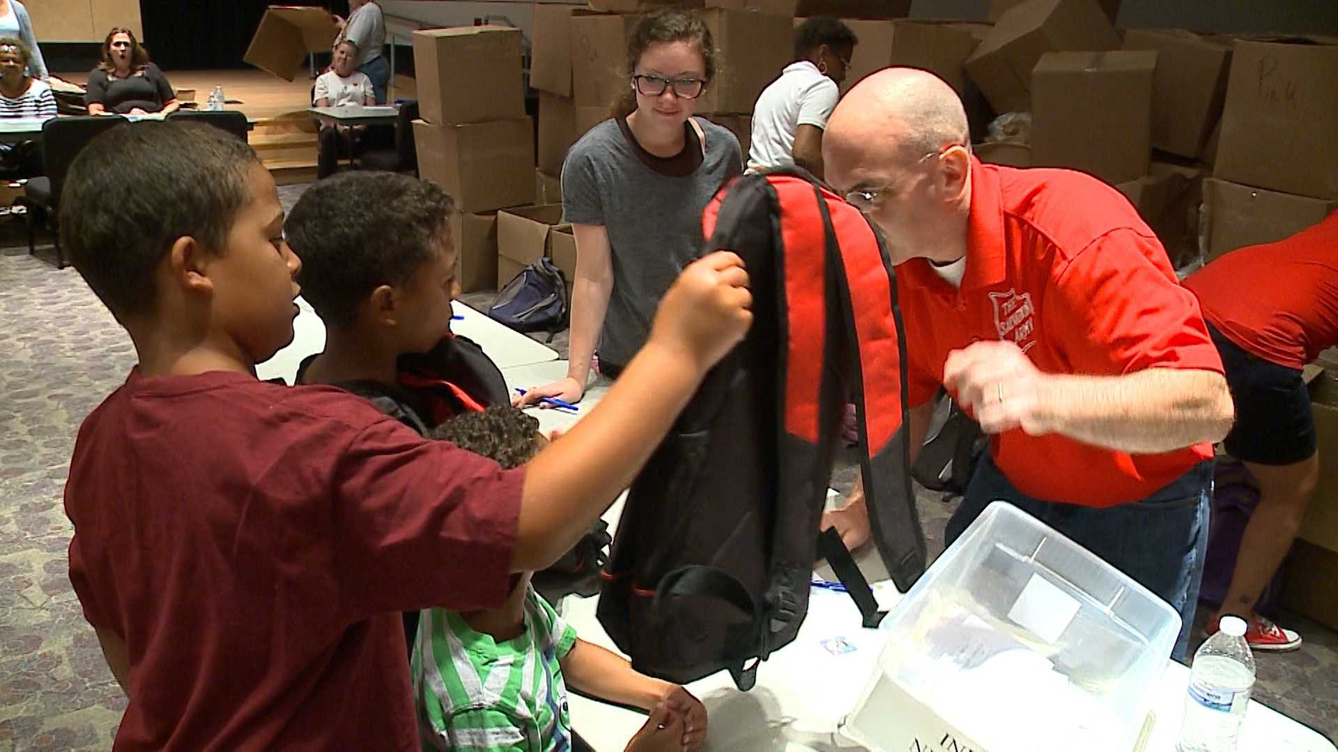 Students pick up backpacks and supplies Friday at the Salvation Army's Kroc Center.