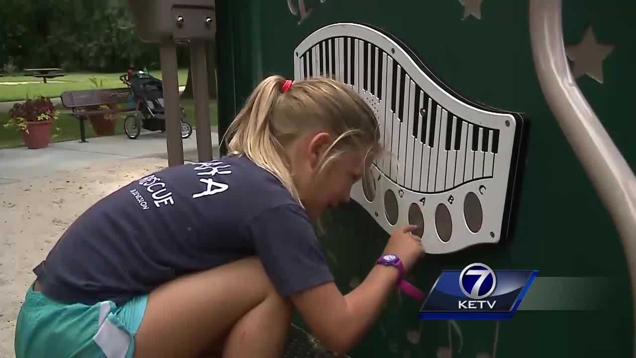 The city is showing off it's new playground equipment at Elmwood Park.
