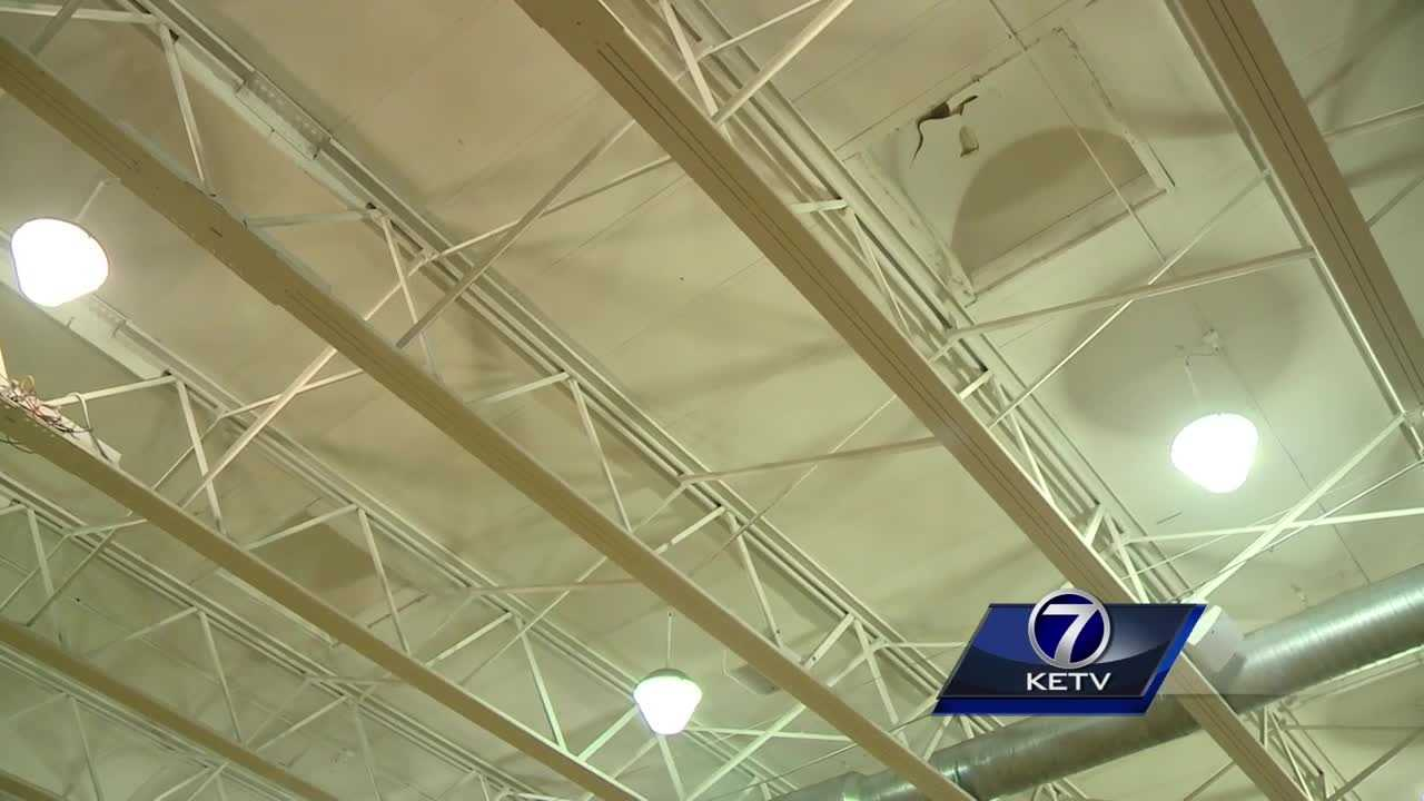 Roncalli Catholic High School President Ann O'Connor said between 600 and 800 gallons of water poured into the gym Tuesday night after high winds blew the roof off.