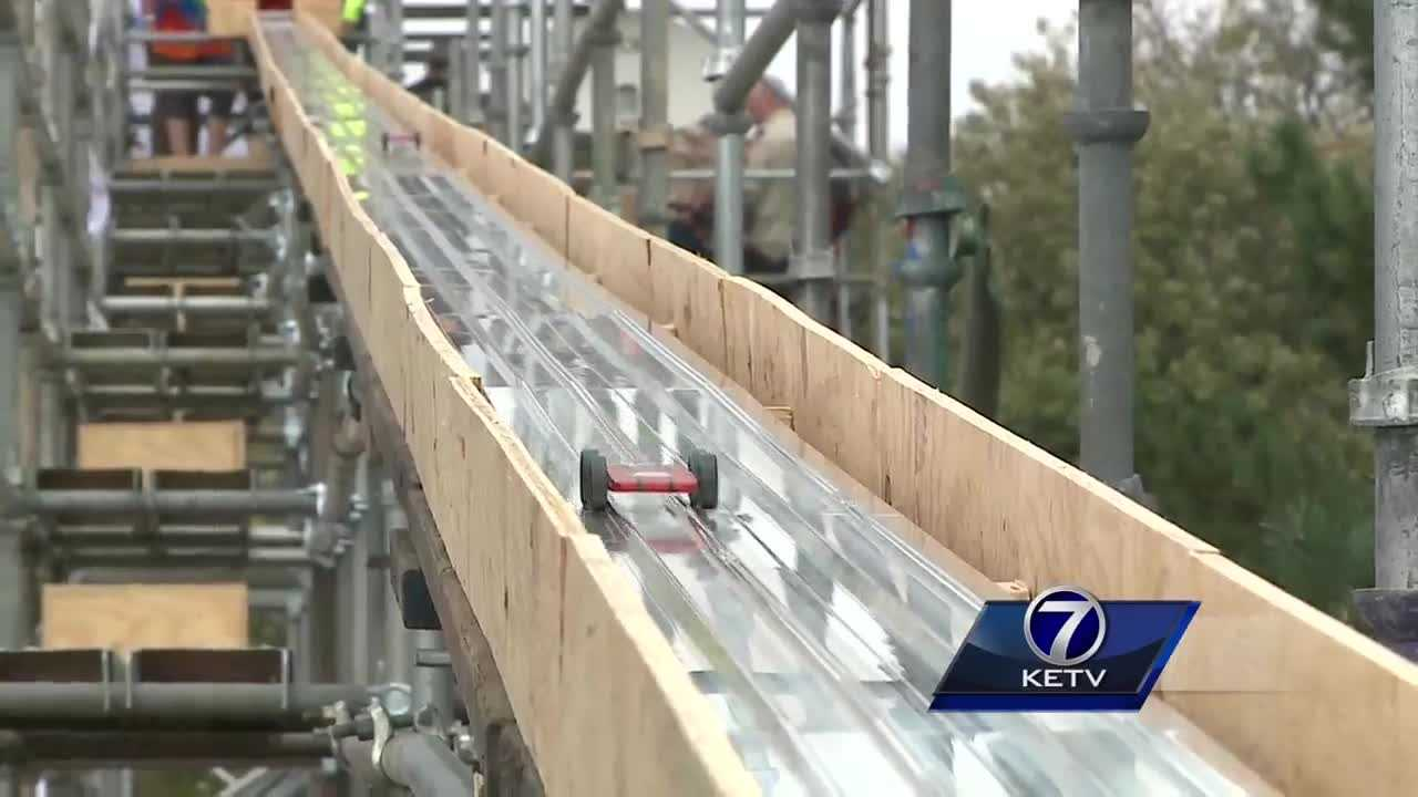 Boy scouts, carpenters, and local businesses come together to build the world's longest Pinewood derby track.