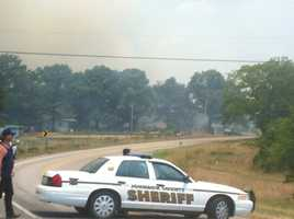Crews work to contain a wildfire in Johnson County near Clarksville.
