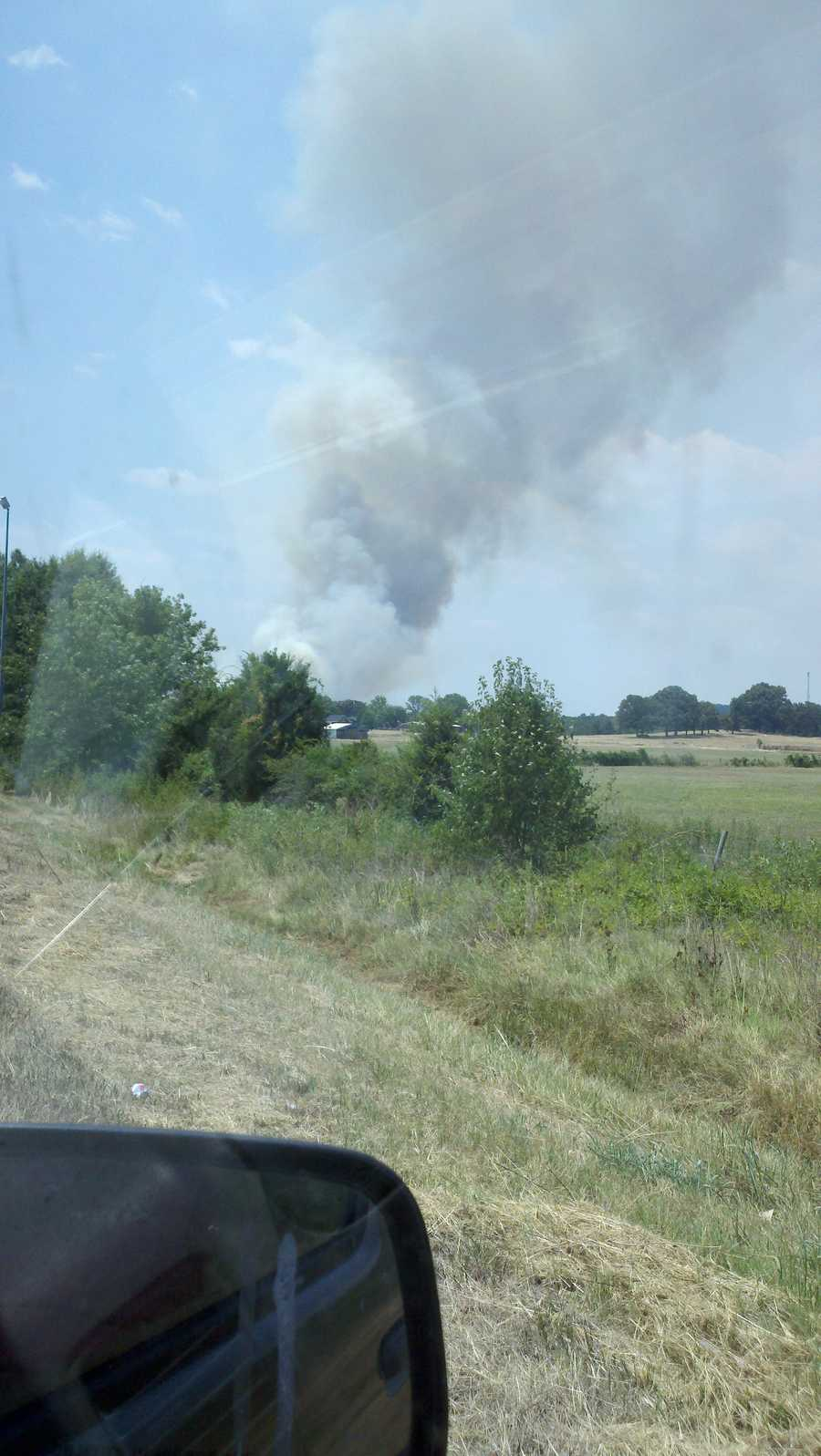 Crews work to contain a wildfire near Clarksville Sunday.