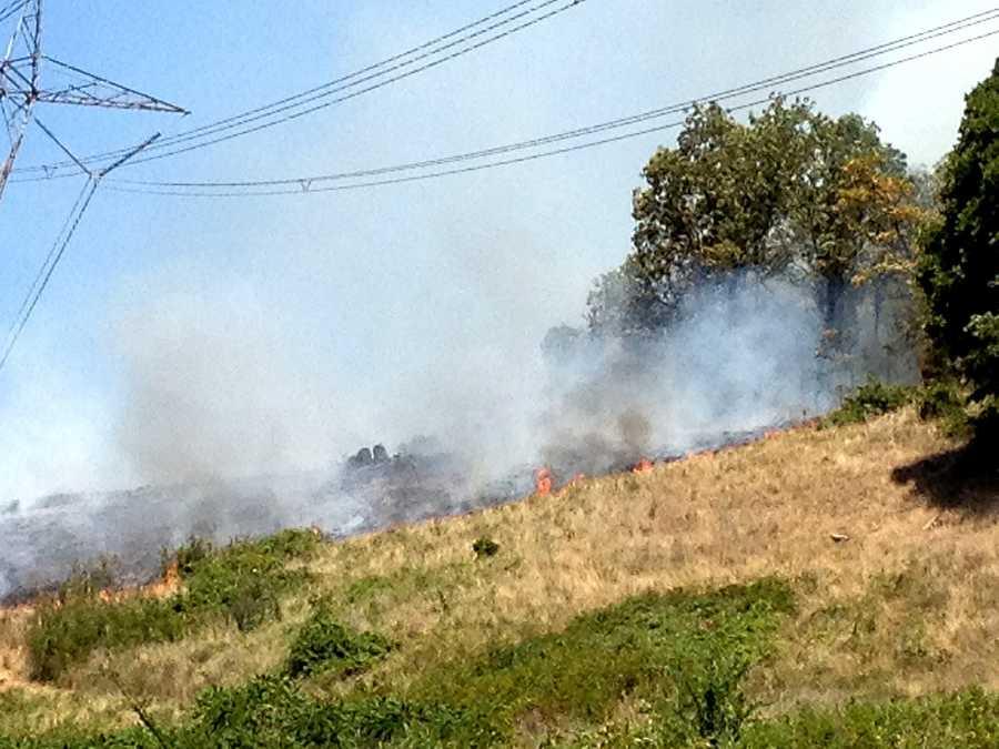 A grass fire burns on Bear Hollow Road in Sebastian County.