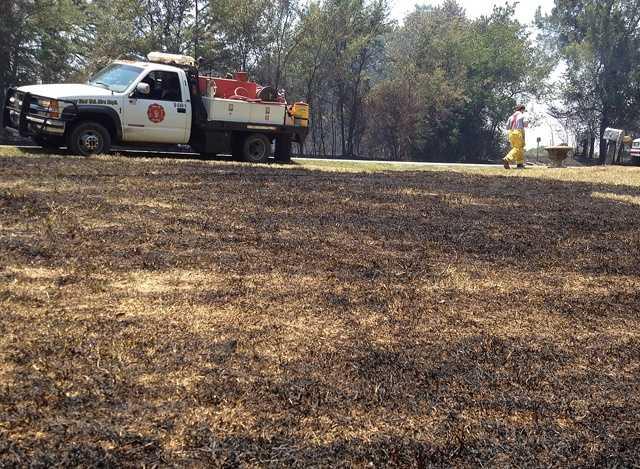 A grass fire shuts down Tennessee Ridge Road in Sebastian County.