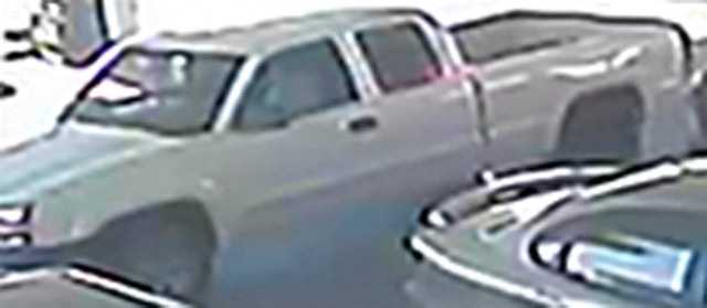 Fort Smith police seek a man who they suspect of passing forged checks taken during a vehicle break-in.