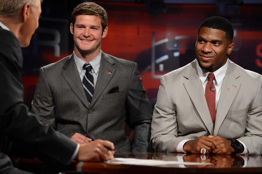 Arkansas quarterback Tyler Wilson and running back Knile Davis at the desk on the set of SportsCenter on ESPN