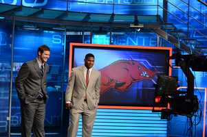 Arkansas quarterback Tyler Wilson and running back Knile Davis in front of the plasma monitor on the SportsCenter set