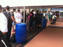 Sunday, the lines to get into the Republican National Convention were long although the pour weather conditions.