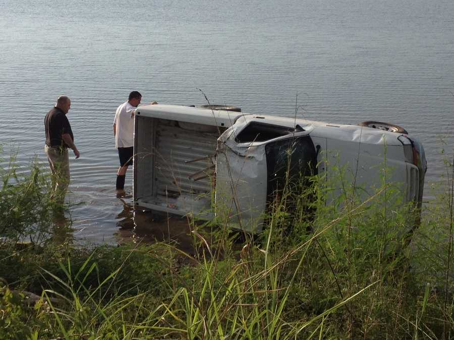 Crawford County officials found this abandoned truck in the Arkansas River. Crews are working to remove it. Officials found no one inside. The truck is located off River Road in the Dyer area, near the Frog Bayou Wildlife Management area.