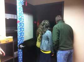 The Duggars peek inside the Christmas edit bay! Check out the gift-wrapped door!