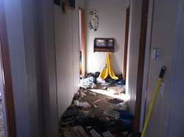 The Hobbs family says they rode out the storm here, in their hallway.