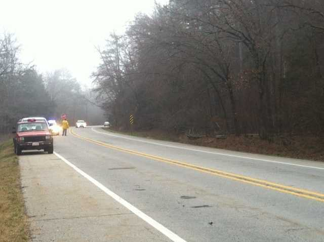 Police said the driver of a bus carrying twenty-one people said he fell asleep behind the wheel and drove off the road.