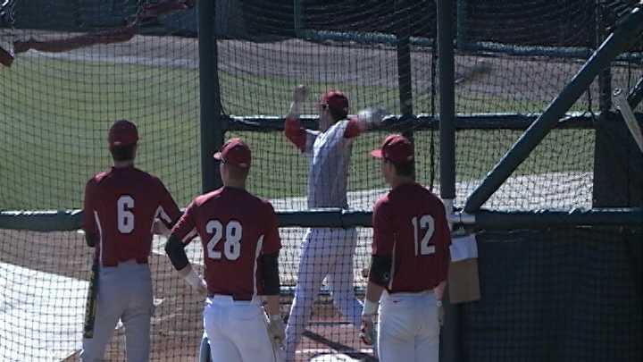 Catcher Jake Wise takes batting practice inside Baum Stadium