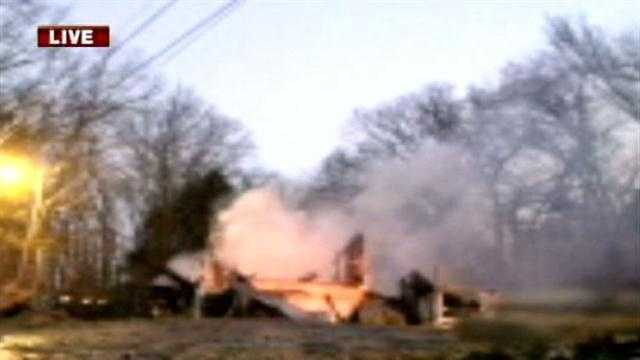 Crews are working to contain a trailer house fire in Mountainburg, no injuries were reported