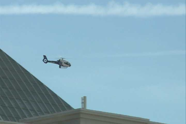 "This picture shows Kelly and the ""Spirit of Mercy"" flying by the Embassy Suites in Rogers."