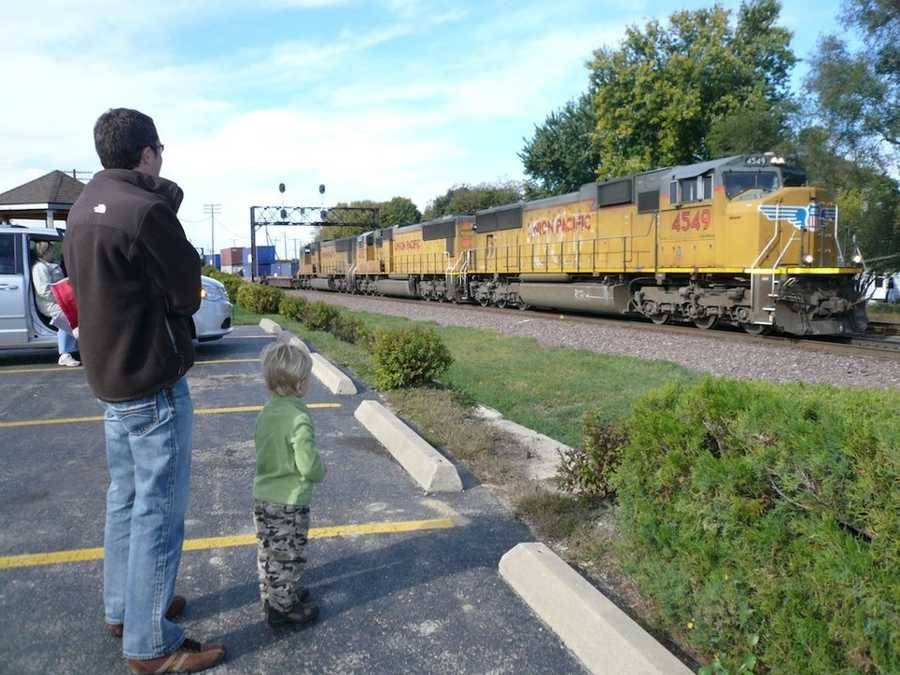 I have always been interested in the railroad.  In fact I used to hop freight trains in high school and college.  Sorry Mom and Dad!  My jumping days are over, but it's fun taking Brett out to watch the trains roll through.  He loves to watch the locomotives pass by.