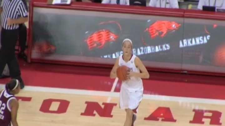 Arkansas guard Calli Berna passes the basketball against Texas A&M