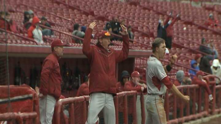 Arkansas coach Dave Van Horn, pitcher Ryne Stanek and outfielder Jacob Morris