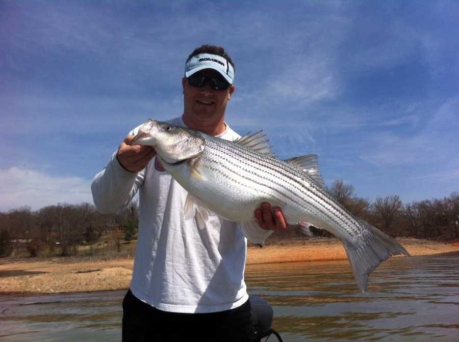 3. His favorite hobby is fishing. He would like to thank Beaver Lake for this 14 lb. striper. It was tasty.
