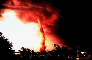 On June 5, 1996 a tornado hit Enid, Oklahoma. This classic photograph shows a tornado in its mature stage.