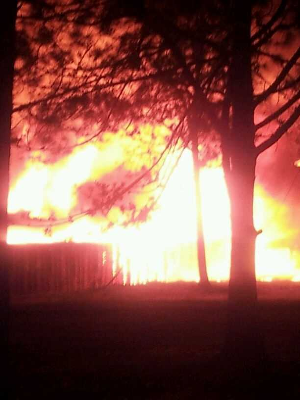 Flames caught Tuesday night in Charleston, Ark.