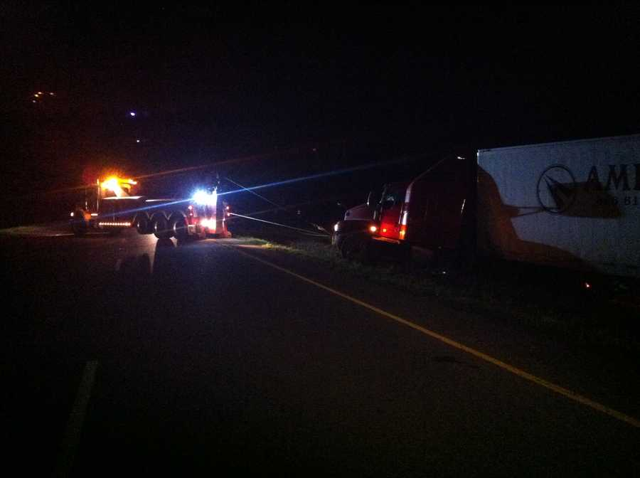 Eastbound lanes were closed on Interstate 40 as road crews pull a semi-truck out of the median.