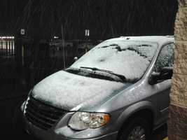 Snow-covered van in Fayetteville.