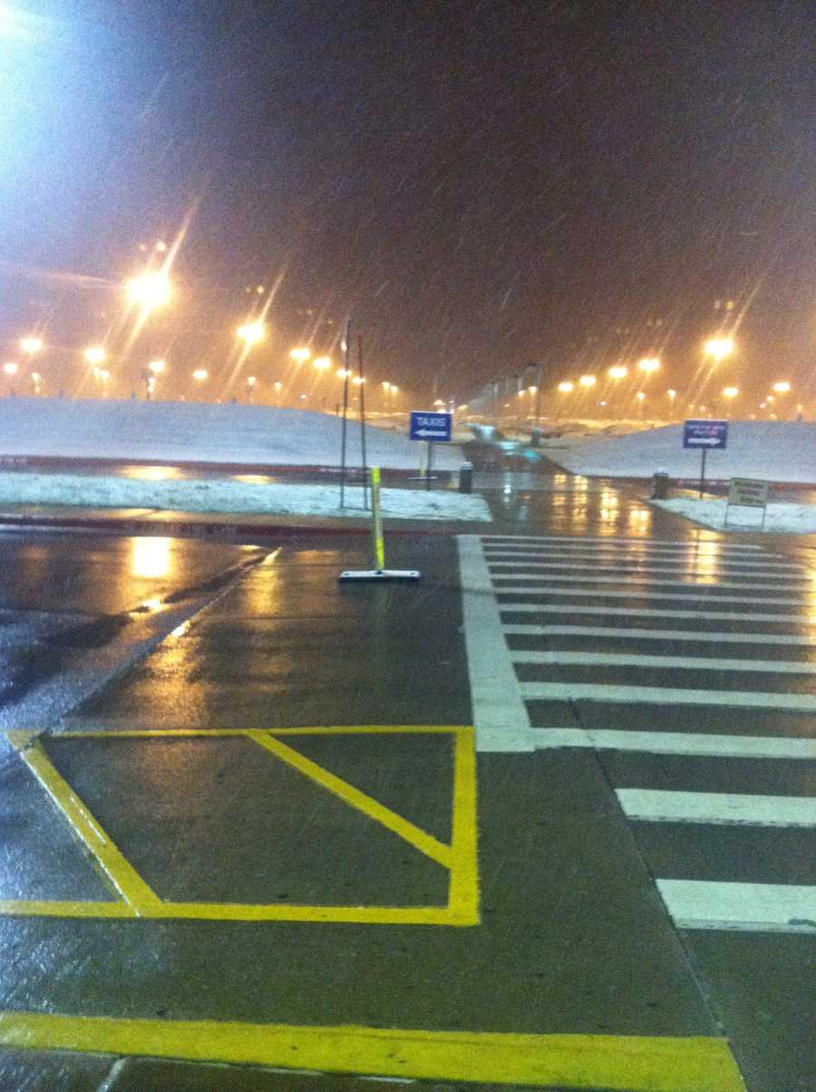 Snow coming down at the Northwest Arkansas Regional Airport.
