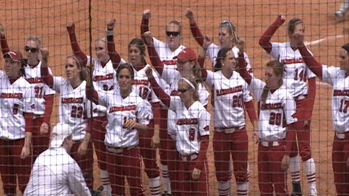 "The Razorback softball team ""Calls the Hogs"" after a victory at Bogle Park."
