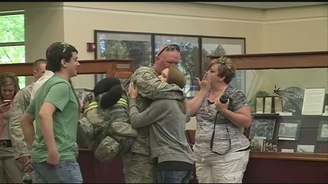 Airmen from the 188th Fighter Wing's Security Forces Squadron, say goodbye before a six month deployment.