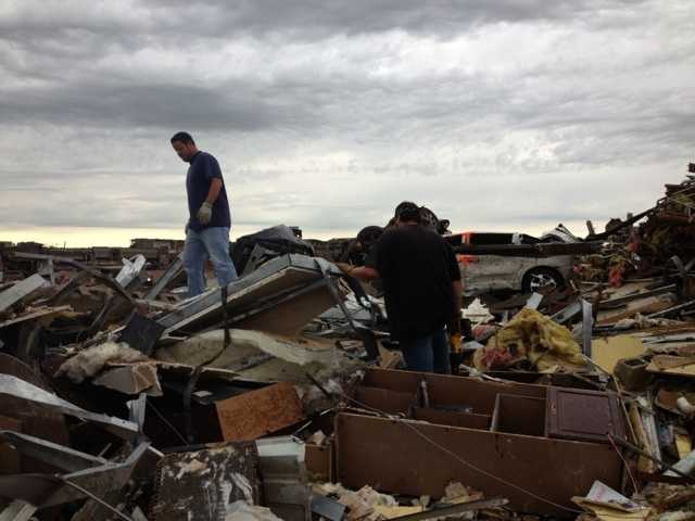 Cleaning up debris in Moore, Okla.