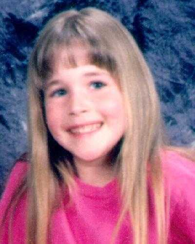 Morgan Nick was abducted by an unknown white male while she was playing at an Alma ballpark on June 9, 1995.  She was 6 years old.  She has 5 visible silver caps on her molars.