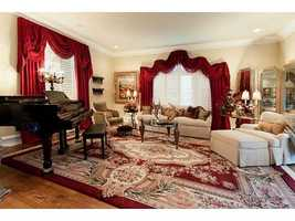 A cozy parlor is the perfect place to chat with friends and family or relax with some soothing piano melodies.