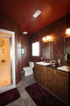 This spacious bathroom features his and her sinks, giving plenty of space for morning primping.