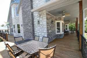 The wrap-around porch meets into a beautiful deck on the back corner of the home.