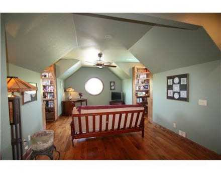 An extra room upstairs with plenty of wall space makes for the perfect game room or reading area.