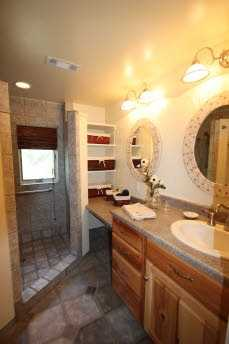 The guest house bathroom is large with multiple mirrors so guests will not feel cramped in the mornings.