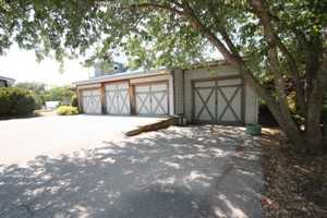 Just off the house connected by the carport is an additional four car garage.